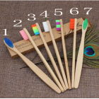 China Cheap bamboo toothbrush with laser engraving logo factory